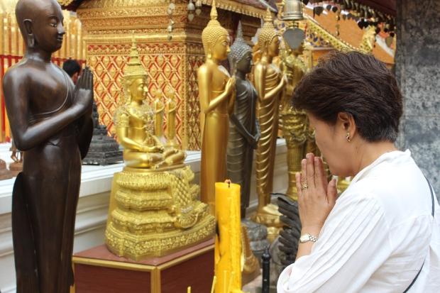 Woman praying in Chiang Mai