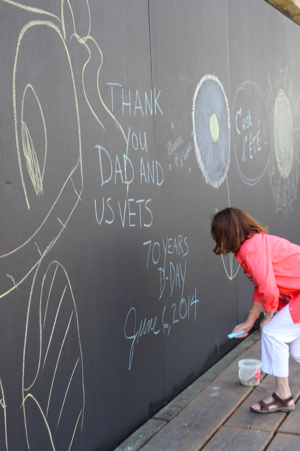 Mom adding to the chalk mural