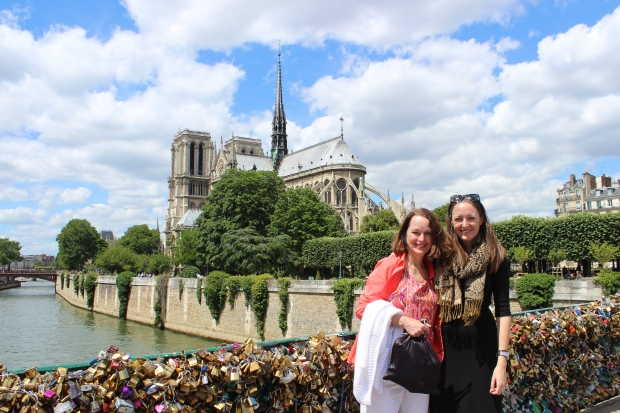 Recreating our photo 4 years ago in front of Notre Dame