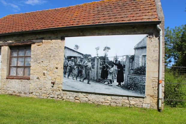 War photographs enlarged on buildings