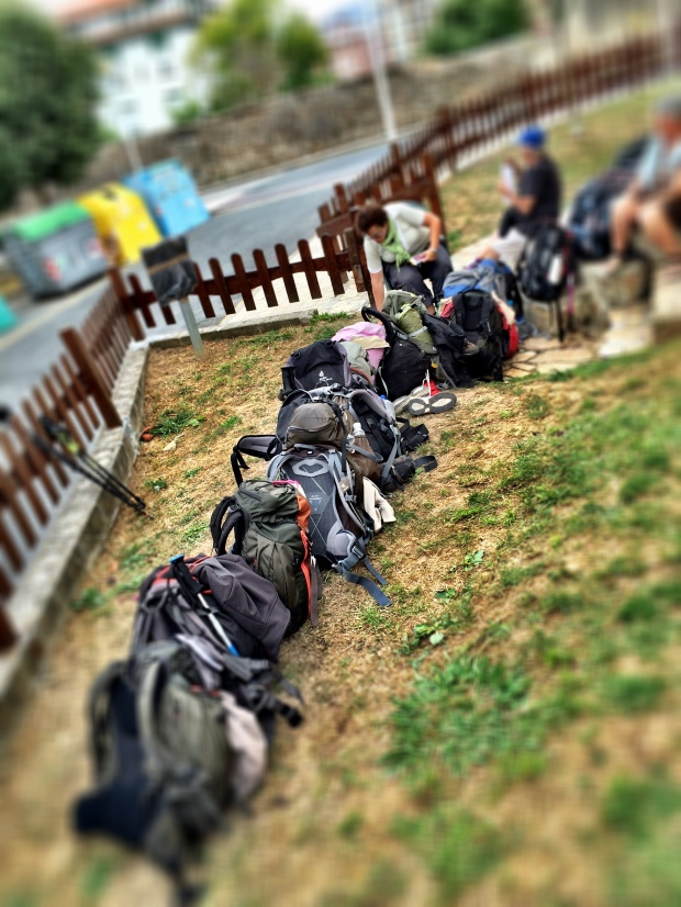 Packs lined up before the albergue opened.