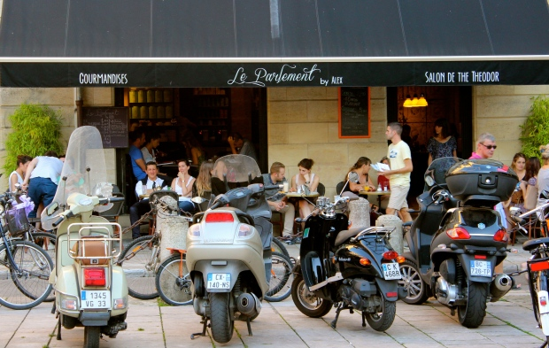 Motos lined up outside a cafe.