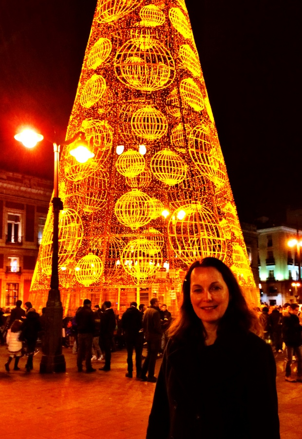 Mom posing with the Christmas tree in Sol (no pine trees here)