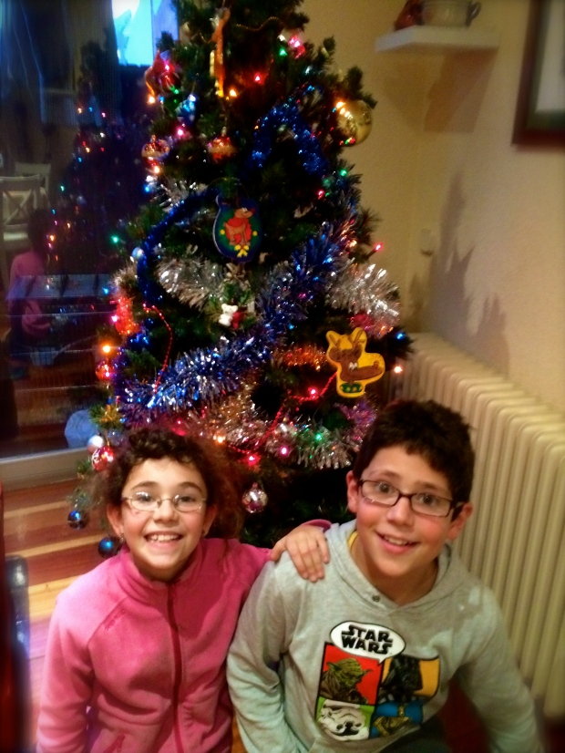 The kids posing with their tree