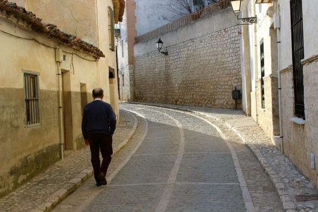 An abuelo walking to evening mass