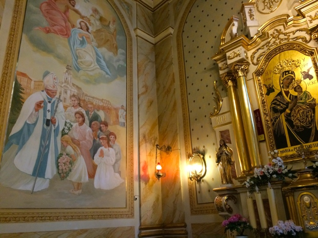 Painted scenes of John Paul II in the church where he was baptized