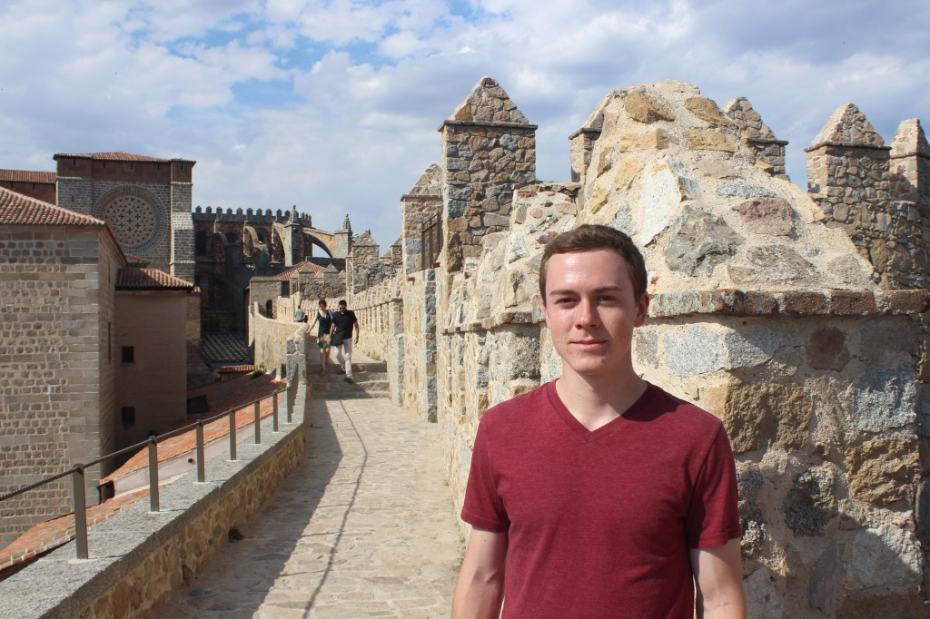 Brother exploring Avila's famous walls